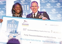 Essence Carter, 16-year-old from the Fort Riley youth center has been named the Southwest Military Youth of the Year by the Boys & Girls Clubs of America. This distinguished honor comes along with a $40,000 scholarship. After being named the Kansas Military Youth of the Year, Essence traveled to San Antonio June 9 for the regional level and was selected among 8 total finalists in the southwest. Col. James J. Love, Installation Management Command, G-9 Chief of Staff, presented her with the scholarship award. She will go on to compete for the National Military Youth of the Year title this fall at the Army and Navy Club on Farragut Square. Washington, D.C., Sept. 9.