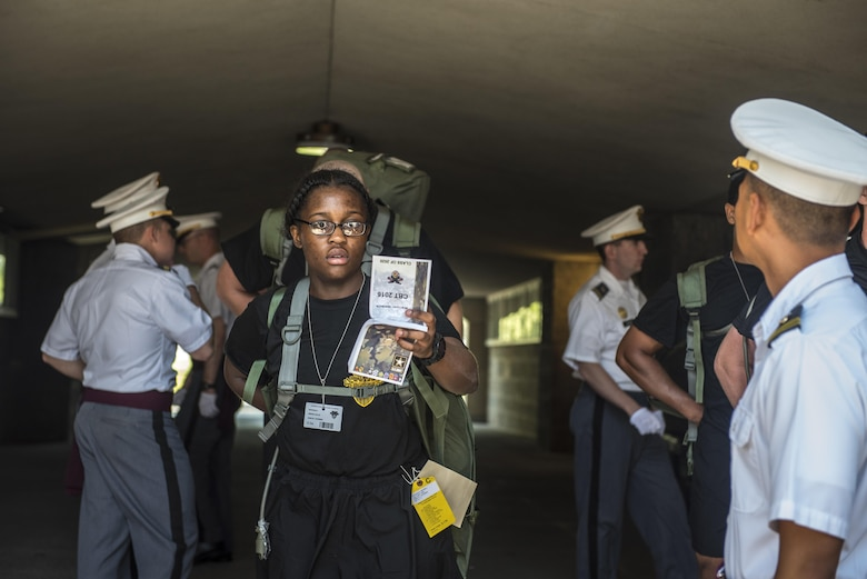 Future Cadets at the U.S. Military Academy at West Point, N.Y., study their Cadet Basic Training Smart Books during R-day, June 27. (U.S. Army photo by Sgt. 1st Class Brian Hamilton/ released)
