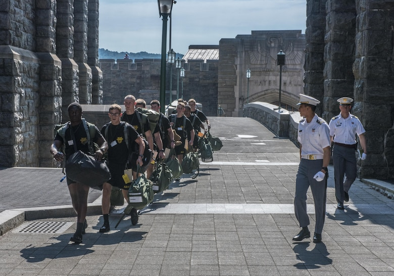 Future Cadets at the U.S. Military Academy at West Point, N.Y., scurry across a bridge to their next in-procesing station during R-day, June 27. (U.S. Army photo by Sgt. 1st Class Brian Hamilton/ released)