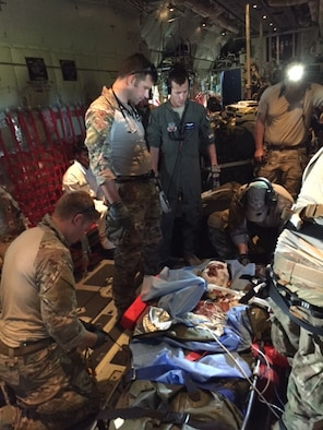 Maj. Alex Keller (left center), a surgeon with the 720th Special Tactics Group, supervises the medical treatment of a burn patient on an HC-130 Combat King II, June 23, 2016. Keller, alongside pararescuemen and aircrew from the 372nd Rescue Group, assisted in the rescue and evacuation of fishermen stranded off the shore of Bermuda when their vessel caught fire. (Courtesy photo)