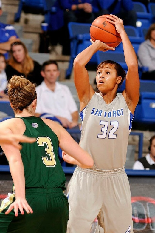 1st Lt. Dymond James, 460th Operations Group staff instructor, pulls up for a shot during her 2012-2013 season. James was a standout playing basketball for the U.S. Air Force Academy women's team and recently made the U.S. Air Force Women's Basketball Team. (Courtesy photo)
