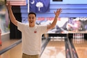U.S. Air Force Airman 1st Class Sean Sweeney, 20th Fighter Wing Public Affairs broadcast journalist, celebrates after bowling a strike at Shaw Lanes during Comprehensive Airman Fitness Week at Shaw Air Force Base, S.C., June 29, 2016. CAF Week provided Team Shaw members an opportunity to build camaraderie group activities in order to emphasize the CAF concept of Airmen and families taking care of themselves and each other. (U.S. Air Force photo by Senior Airman Zade Vadnais)