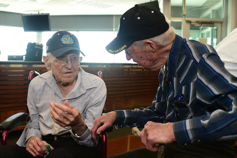 (left) Ret. U.S. Air Force Lt. Col. Morris L. Quick Jr. and Ret. U.S. Air Force Col. Bill Myers, reminisce about their experiences as pilots June 17, 2016, at the Army Aviation Facility on Buckley Air Force Base, Colo. Quick and Myers are both part of the Order of Daedalians, which honors WWI aviators as the first to fly United States aircraft in a time of war. The two men, now in their late 90's, both served in WWII, Korea and Vietnam. Both men have a connection with Colorado. Quick flew out of Buckley Field during WWII and Myers was a part of the Colorado Air National Guard. (U.S. Air Force photo by Airman 1st Class Luke W. Nowakowski/Released)