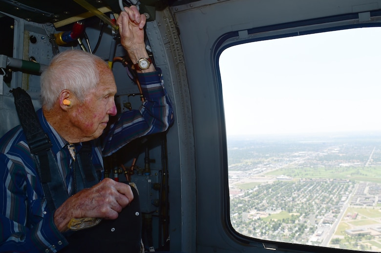 Ret. U.S. Air Force Col. Bill Myers looks out of a Sikorsky UH-60 Black Hawk helicopter window June 17, 2016, in Denver. Quick and Myers are both part of the Order of Daedalians, which honors WWI aviators as the first to fly United States aircraft in a time of war. The two men, now in their late 90's, both served in WWII, Korea and Vietnam. Both men have a connection with Colorado. Quick flew out of Buckley Field during WWII and Myers was a part of the Colorado Air National Guard. (U.S. Air Force photo by Airman 1st Class Luke W. Nowakowski/Released)