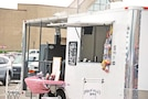Every Saturday at the Downtown Farmers' Market in Manhattan, Kansas, shoppers can treat themselves to local barbecue cooked up by vendors on site. Food trucks are regular vendors prepared to serve up their signature sauces.