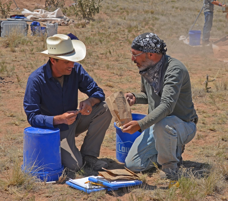 ABIQUIU LAKE, N.M. -- Dr. Sam Duwe (left) talks with undergraduate student Ray Frazier about his finds, June 21, 2016.