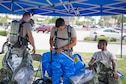 Members of 45th Medical Group's bioenvironmental flight suit up for training and respond to a simulated incident at the Patrick Air Force Base Post Office June 29, 2016. Their goal during the exercise was to train in identifying and evaluating environments that could harm personnel and families at the installation. In addition, they tested their response time and the safety equipment they are required to use when a HAZMAT threat exists. (U.S. Air Force photo by Matthew Jurgens/Released)