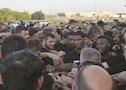 Soldiers and players put their fists in a circle following the training event.