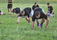 K-State players conduct bear crawls.