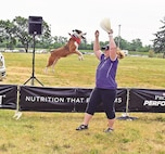 Moretz and Monster, an Australian shepherd mix, show off how high Monster can jump despite his little size for an audience at the Fort Riley Main Post Exchange. Moretz offered lessons on obedience and proper play with dogs during the three shows held at the PX.