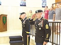 Brig. Gen. Patrick Frank, left, 1st Infantry Division and Fort Riley deputy commanding general, and Command Sgt. Maj. Jonathan D. Stephens, 1st Inf. Div. Artillery senior noncommissioned officer, salute while members of the Nebraska National Guard's 67th Battlefield Surveillance Brigade stand at attention during a wreath-laying ceremony at the Eisenhower Presidential Library, Museum and Boyhood Home in Abilene, Kansas. Frank and Stephens laid a wreath at the head of the former president's gravestone during the ceremony.