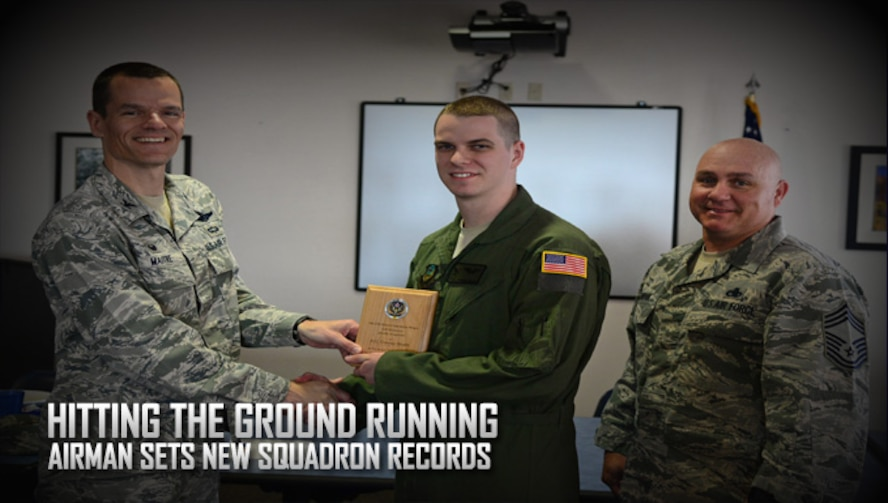 U.S. Air Force Airman 1st Class Connor Brush, 33rd Special Operations Squadron MQ-9 sensor operator, receives the Top III Hard Charger award from Col. Ben Maitre, 27th Special Operations Wing commander, and Chief Master Sgt. Scott Samdahl, 27th SOW command chief, May 12, 2016, at Cannon Air Force Base, N.M. Brush was nominated and selected for his unmatched professionalism, success in job performance, and for breaking various records within the squadron. (U.S. Air Force photo/Senior Airman Chip Slack)