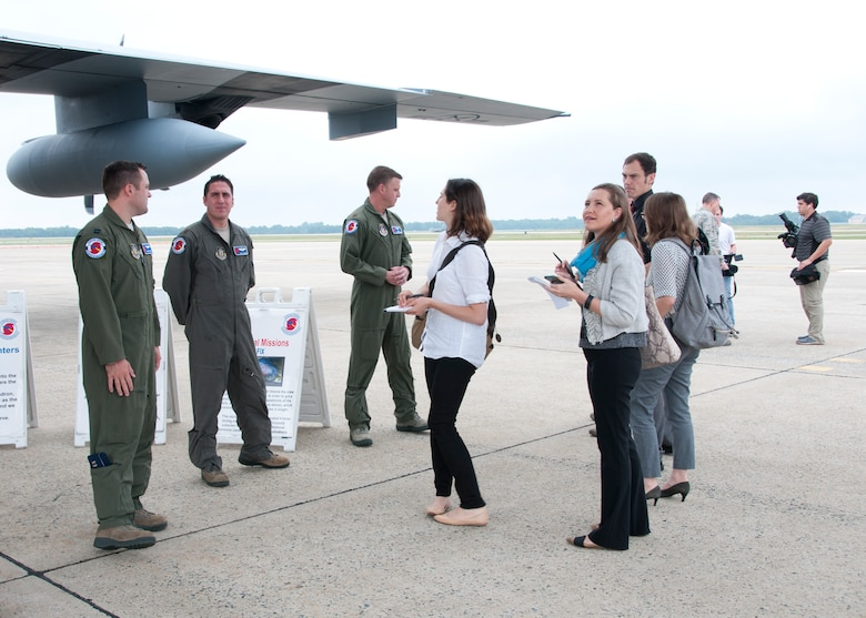 Members of the media, to include CNN, Air Force Times and Aviation Week, interact with members of the 53d Weather Reconnaissance Squadron during a C-130 Hercules special-mission demonstration on the Joint Base Andrews, Md., flight line June 28, 2016. In honor of the 100th anniversary of U.S. air reserve power, media members were invited to an event showcasing special missions conducted by C-130s in Air Force Reserve Command, to include weather surveillance, firefighting and aerial spraying. (U.S. Air Force photo/Staff Sgt. Kat Justen)