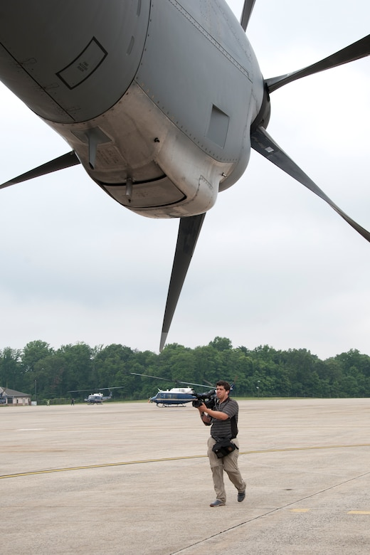Daniel Wolfolk, Air Force Times videographer, captures footage of a C-130 Hercules on the Joint Base Andrews, Md., flight line June 28, 2016. In honor of the 100th anniversary of U.S. air reserve power, media members were invited to an event showcasing special missions conducted by C-130s in Air Force Reserve Command, to include weather surveillance, firefighting and aerial spraying. (U.S. Air Force photo/Staff Sgt. Kat Justen)