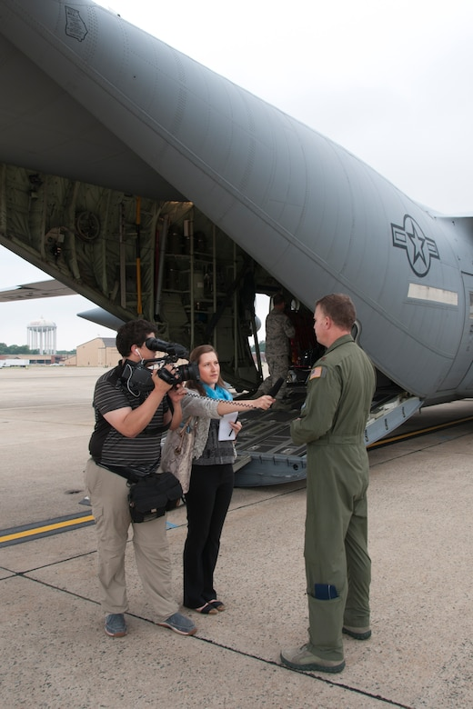"Journalists with the Air Force Times interview Maj. Kyle Larson, 53d Weather Reconnaissance Squadron ""Hurricane Hunters"" meteorologist, during a C-130 Hercules special-missions demonstration on the Joint Base Andrews, Md., flight line June 28, 2016. In honor of the 100th anniversary of U.S. air reserve power, media members were invited to the event, which highlighted C-130 missions to include weather surveillance, firefighting and aerial spraying. (U.S. Air Force photo/Staff Sgt. Kat Justen)"
