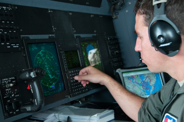 "Major John Gharbi, 53d Weather Reconnaissance Squadron ""Hurricane Hunters"" navigator, checks the weather during a flight over Maryland June 28, 2016. As part of the 100th anniversary of air power in the U.S. military, members of the media were invited to fly with the Hurricane Hunters and learn about their weather surveillance mission. With ten deployable C-130s, the unit has the only routine aerial weather reconnaissance mission in the world. (U.S. Air Force photo/Staff Sgt. Kat Justen)"