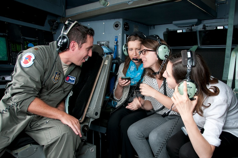"Major John Gharbi, 53d Weather Reconnaissance Squadron ""Hurricane Hunters"" navigator, speaks with members of the media during a flight over Maryland June 28, 2016. As part of the 100th anniversary of air power in the U.S. military, members of the media were invited to fly with the Hurricane Hunters and learn about their weather surveillance mission. With ten deployable C-130s, the unit has the only routine aerial weather reconnaissance mission in the world. (U.S. Air Force photo/Staff Sgt. Kat Justen)"