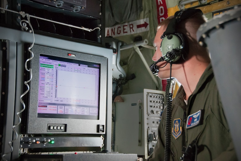 Staff Sgt. Jesse Jordan, 53d Weather Reconnaissance Squadron loadmaster, monitors weather data after deploying a dropsonde during a flight off of the east coast of the United States, June 28, 2016. A dropsonde is used by the Hurricane Hunters to collect temperature, humidity, wind speed and direction of weather systems. The information is then sent to the National Hurricane Center in Miami to monitor tropical storms. As part of the 100th anniversary of air power in the U.S. military, members of the media were invited to fly with the Hurricane Hunters and learn about their weather surveillance mission. (U.S. Air Force photo/Staff Sgt. Kat Justen)