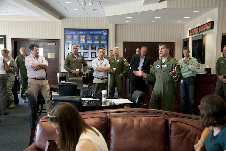 Brigadier Gen. Albert V. Lupenski, Headquarters U.S. Air Force Reserve Plans, Programs and Requirements director, provides an Air Force Reserve Command C-130 mission briefing to a group of congressional staffers at the passenger terminal distinguished visitor's lounge, Joint Base Andrews, Md., June 28, 2016. In honor of the 100th anniversary of U.S. air reserve power, staffers were invited to an event showcasing special missions conducted by C-130s in AFRC, to include weather surveillance, firefighting and aerial spraying. (U.S. Air Force photo/Staff Sgt. Kat Justen)