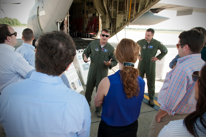 Major Brad Roundtree, 53d Weather Reconnaissance Squadron pilot, discusses his unit's mission with congressional staff members on the Joint Base Andrews, Md., flight line June 28, 2016. In honor of the 100th anniversary of air reserve power, members of the 53d WRS visited Andrews to participate in a C-130 Hercules special-missions demonstration. The 53d WRS is the only flying weather reconnaissance unit in the world flying routine missions to survey tropical and winter storms. (U.S. Air Force photo/Staff Sgt. Kat Justen)
