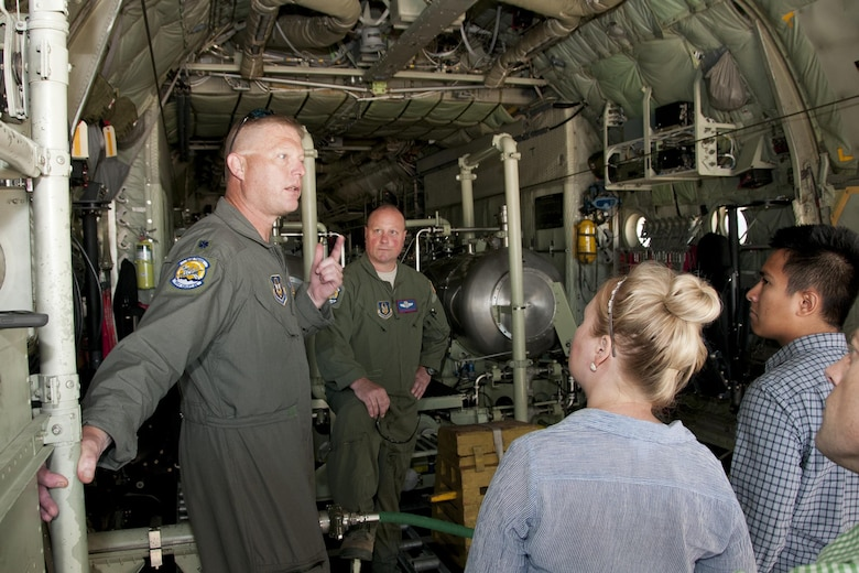 Lieutenant Col. Karl Haagsma, 757th Airlift Squadron medical entomologist, discusses his unit's mission with congressional staff members on the Joint Base Andrews, Md., flight line June 28, 2016. In honor of the 100th anniversary of air reserve power, members of the 53d WRS visited Andrews to participate in a C-130 Hercules special-missions demonstration. The 757th AS has the specialized mission of aerial spray capability to control disease-carrying insects, pest insects, undesirable vegetation and to disperse oil spills in large bodies of water. (U.S. Air Force photo/Staff Sgt. Kat Justen)