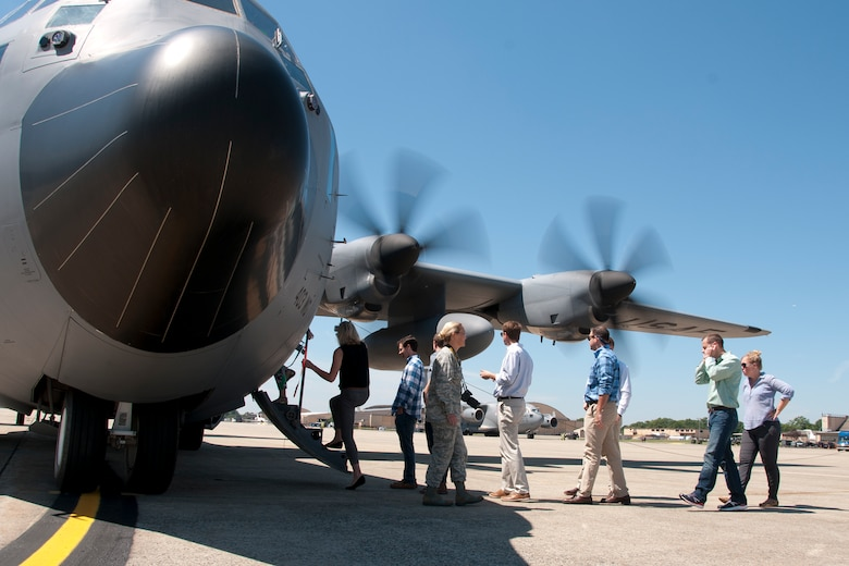 Congressional staff members embark on a 53d Weather Reconnaissance Squadron C-130 Hercules on the Joint Base Andrews, Md., flight line June 29, 2016. In honor of the 100th anniversary of U.S. air reserve power, congressional staff members were invited to an event showcasing special missions conducted by C-130s in the Air Force Reserve Command, to include weather surveillance, firefighting and aerial spraying. (U.S. Air Force photo/Staff Sgt. Kat Justen)