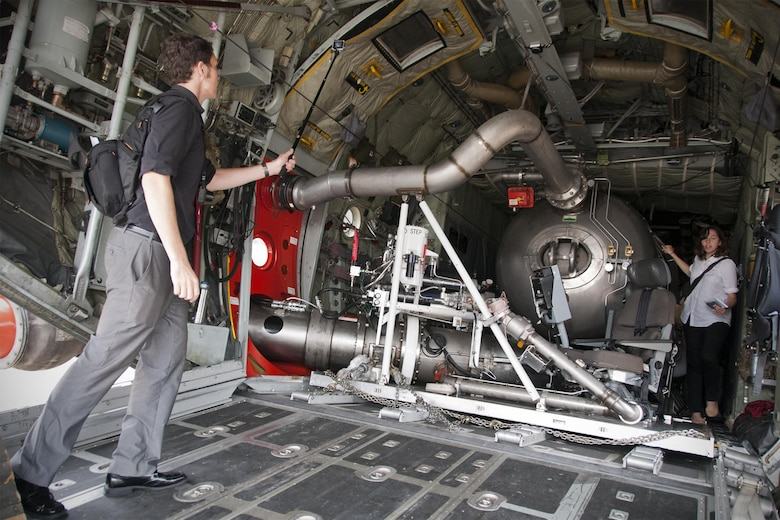 James Drew, Aviation Week defense editor (left), captures footage with a handheld camera of the S-duct fire suppression system inside a 302nd Airlift Wing C-130 Hercules on the Joint Base Andrews, Md., flight line June 28, 2016. In honor of the 100th anniversary of U.S. air reserve power, media members were invited to an event showcasing special missions conducted by C-130s in the Air Force Reserve Command, to include weather surveillance, firefighting and aerial spraying. (U.S. Air Force photo/Staff Sgt. Kat Justen)