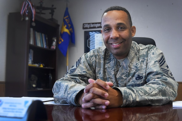 Chief Master Sgt. Barrington Bartlett, the 49th Wing command chief, poses for a portrait in his office at Holloman Air Force Base, N.M., on June 27. Bartlett, who formerly served as the 56th Maintenance Group superintendent at Luke Air Force Base, Ariz., is Holloman's newest command chief. (U.S. Air Force photo by Staff Sgt. Eboni Prince)