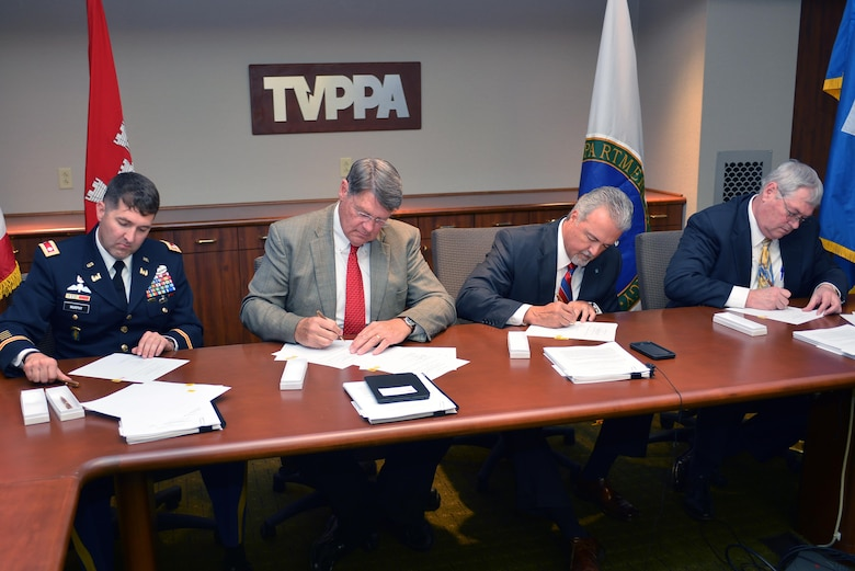 Lt. Col. Stephen Murphy, U.S. Army Corps of Engineers, Nashville District commander, Jack Simmons, Tennessee Valley Public Power Association, Inc., vice president, John McCormick, Tennessee Valley Authority, vice president of Safety, River Management and Environmental and Ken Legg, Southeastern Power Administration administrator sign a Memorandum of Agreement June 27, 2016, in Chattanooga, Tenn.