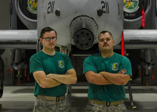Senior Airmen Jonathan Wirkkala, left, 25th Aircraft Maintenance Unit avionics systems technician, and Jarred Sozzi, 25th Aircraft Maintenance Unit electronic and environmental systems technician, pose in front of an A-10 Thunderbolt II at Osan Air Base, Republic of Korea, June 24, 2016. The two maintenance Airmen were life-long fans of the A-10, leading them to choose careers working on the aircraft after enlisting in the Air Force. (U.S. Air Force photo by Senior Airman Victor J. Caputo/Released)
