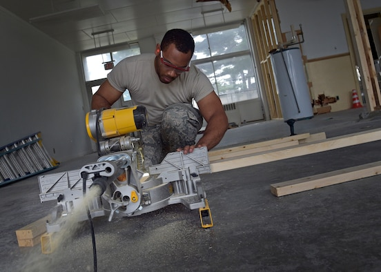 U.S. Air Force Airman 1st Class Victor Blake, a structural journeyman with the 35th Civil Engineer Squadron, cuts blocks of wood during the renovation of the Arts and Crafts Center at Misawa Air Base, Japan, June 27, 2016. Blake and other structures Airmen have been working on this project to combine the building and its annex since April 2016. The finished product will showcase a larger work center to accommodate both facilities. (U.S. Air Force photo by Senior Airman Deana Heitzman)