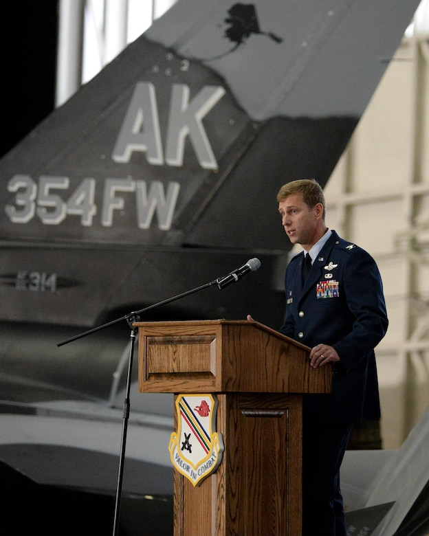 U.S. Air Force Col. David Mineau, the 354th Fighter Wing commander, gives a speech during the wing change of command ceremony, June 29, 2016, at Eielson Air Force Base, Alaska. Mineau said it will be the highest honor of his Air Force career to serve alongside the Icemen Team. (U.S. Air Force photo by Master Sgt. Karen J. Tomasik/Released)