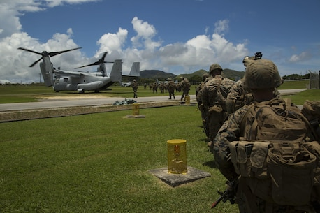 Marines with Helo Company, 2nd Battalion, 4th Marine Regiment, 31st Marine Expeditionary Unit prepare to board MV-22B Ospreys as part of scenario based training in preparation for the 31st MEU's upcoming fall deployment June 25, 2016 at Camp Hansen in Okinawa, Japan.(U.S. Marine Corps photo by Cpl. Samantha Villarreal/Released)