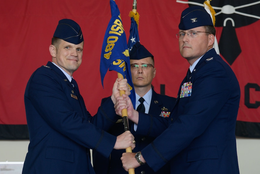 Col. James Brown, 408th Intelligence, Surveillance and Reconnaissance Wing commander, and Col. James Mock, 694th ISR Group commander, pose for a photo during a change of command ceremony at Osan Air Base, Republic of Korea, June 30, 2016. Mock returned to Osan after 30 years to command the 694th ISRG. (U.S. Air Force photo by Senior Airman Dillian Bamman/Released)