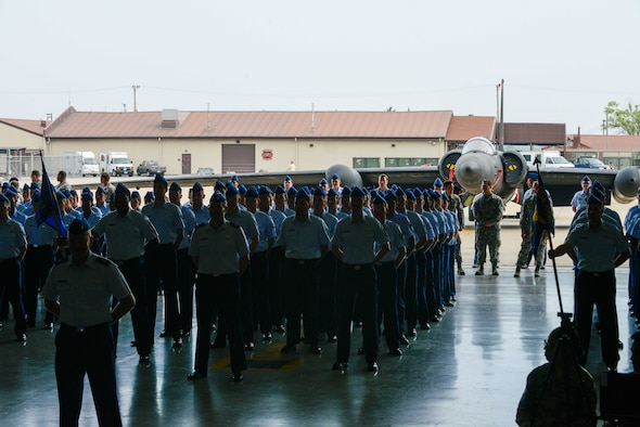 Airmen from the 694th Intelligence, Surveillance and Reconnaissance Group stand in formation during a change of command ceremony at Osan Air Base, Republic of Korea. Col. James Mock accepted command of the 694th ISRG during the ceremony after previously living in Korea as a young student 30 years ago. (U.S. Air Force photo by Senior Airman Dillian Bamman/Released)