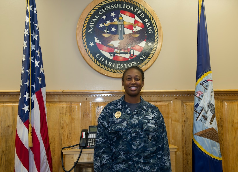 Yeoman First 1st Class Kealy Lee, an administrative assistant for the Admin Officer at the Naval Consolidated Brig at Joint Base Charleston – Naval Weapons Station poses for a photograph in the conference room June 28, 2016. Independence Day means a time to celebrate everything that our forefathers and everyone that went before us, to allow us to be able to join the military as a result of their sacrifices for our freedom. (U.S. Air Force photo/Airman 1st Class Kevin West)