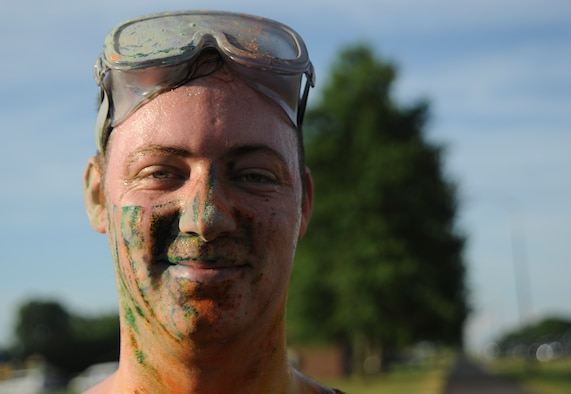 U.S. Air Force Airman 1st Class Zachary Taylor, a participant of the Lesbian, Gay, Bisexual and Transgender Pride Month Rainbow Run 5K, displays the effects of the colored powder after the run at Whiteman Air Force Base, Mo., June 24, 2016. Participants were given eye protection before the run to ensure their safety. (U.S. Air Force photo by Senior Airman Danielle Quilla)
