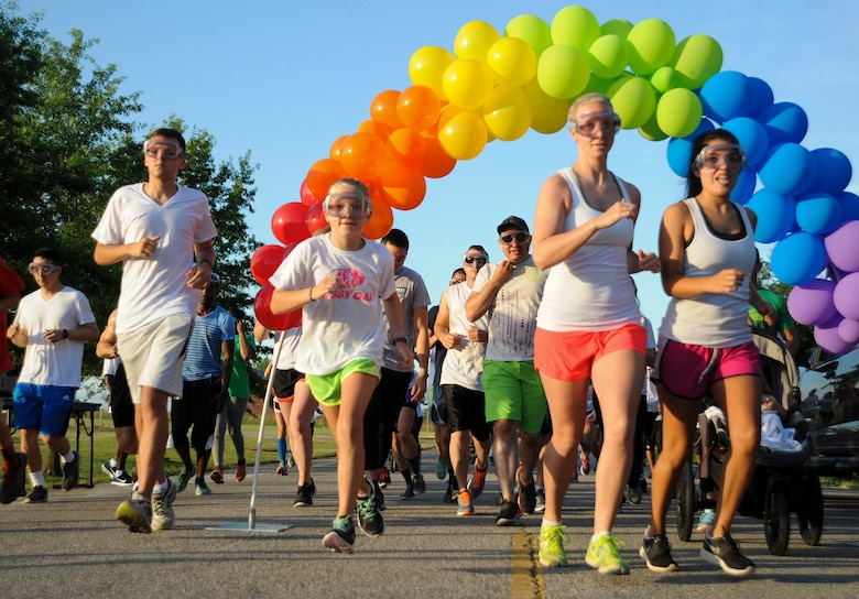 Participants begin running the Lesbian, Gay, Bisexual and Transgender (LGBT) Pride Month Rainbow Run 5K at Whiteman Air Force Base, Mo., June 24, 2016. A total of 75 people participated in the run and showed their support to the LGBT community. (U.S. Air Force photo by Senior Airman Danielle Quilla)
