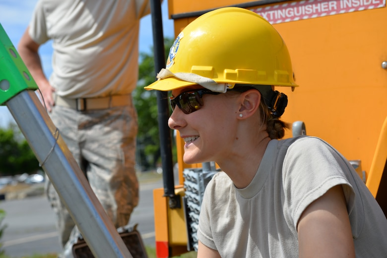 Staff Sgt. Chelsea Kennie, 243rd Engineering Installation Squadron radio frequency transmission technician, smiles after removing outdated coaxial cable from a manhole at Pease Air National Guard Base, N.H., June 17. The team from Portland, M.E. has assisted the 157th Communications Flight with removing over 20,000 feet of cable from manholes at Pease ANGB. (U.S. Air National Guard photo by Tech. Sgt. Erica Rowe)