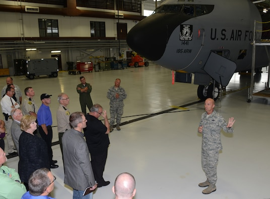 185th Air Refueling Wing, Chief Master Sgt. Phil Frank explains the mission of the 185th ARW to members of area law enforcement agencies while in the main hangar at the Iowa Air National Guard Base in Sioux City, Iowa on June 29, 2016. Members of the group were given the opportunity to see to see a KC-135 up close and ask questions about the unit and the unique mission of the mid-air refueling aircraft while visiting the base during a law enforcement seminar held at the base dining facility. (U.S. Air National Guard photo by: Master Sgt. Vincent De Groot/released)