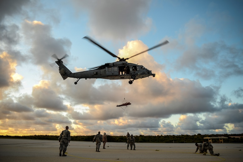 Airmen and Soldiers conduct medical evacuation training with an MH-60 Seahawk during the Jungle Training Operations Course June 15, 2016, at Andersen Air Force Base, Guam. During the course, students also learned jungle survival skills, including land navigation, water purification and evasion techniques. (U.S. Air Force photo by Tech. Sgt. Richard Ebensberger)