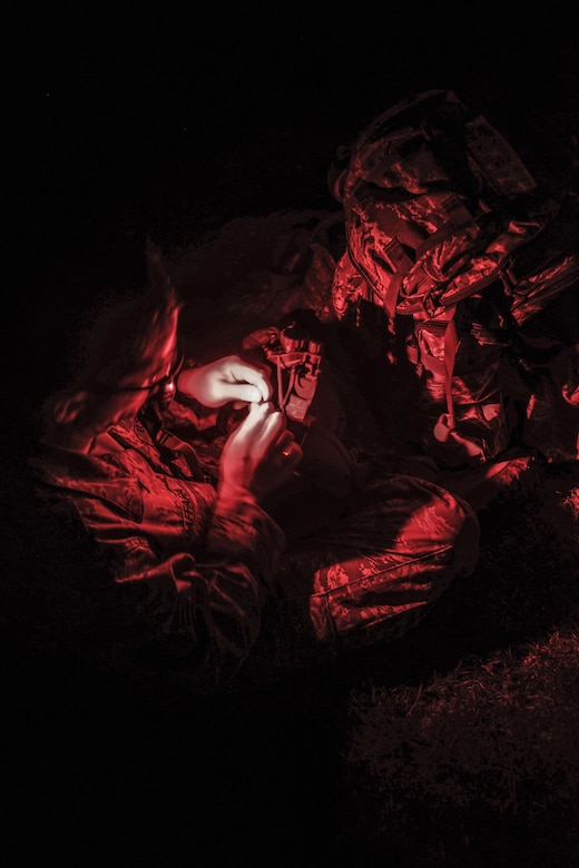 Tech Sgt. Hernan Daffara, Jungle Training Operations Course student from the 644th Combat Communications Squadron, secures a night vision monocular to his helmet during an air assault exercise June 15, 2016, at Andersen Air Force Base, Guam. Conducted by the U.S. Army 25th Infantry Division's Lightning Academy Jungle Operations Training Center from Schofield Barracks, Hawaii, and supported by 736th Security Forces Squadron Commando Warrior cadre, students prepared a simulated patient for medical evacuation. During the course, they also learned survival skills, including land navigation and evasion techniques. (U.S. Air Force photo by Tech. Sgt. Richard Ebensberger)