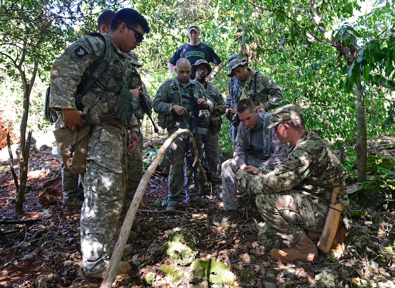 Airmen and Soldiers learn how to set animal traps and snares during the Jungle Training Operations Course June 17, 2016, at Andersen Air Force Base, Guam. From June 15-21, instructors from the U.S. Army 25th Infantry Division's Lightning Academy Jungle Operations Training Center, in Schofield Barracks, Hawaii, travelled to Guam to teach more than 30 Airmen and Soldiers the fundamentals of fighting and surviving in jungles with support from cadre members of the 736th Security Forces Squadron. (U.S. Air Force photo by Senior Airman Joshua Smoot)
