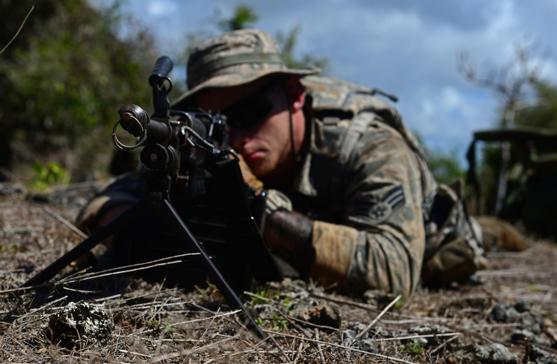 Senior Airman Cody Linday, Jungle Training Operations Course student from the 36th Security Forces Squadron, provides perimeter defense June 17, 2016, at Andersen Air Force Base, Guam. From June 15-21, instructors from the U.S. Army 25th Infantry Division's Lightning Academy Jungle Operations Training Center, in Schofield Barracks, Hawaii, travelled to Guam to teach more than 30 Airmen and Soldiers the fundamentals of fighting and surviving in jungles with support from cadre members of the 736th Security Forces Squadron. (U.S. Air Force photo by Senior Airman Joshua Smoot)