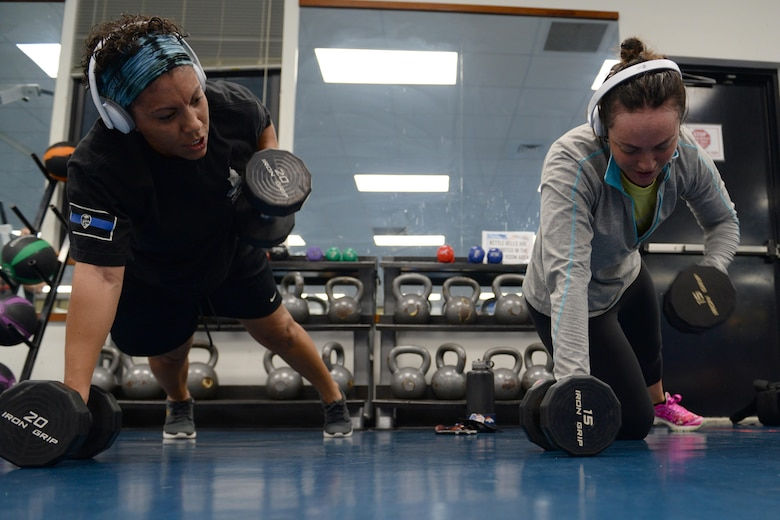 Staff Sgt. Tasha Coolidge, left, 36th Security Forces unit training manager, and her wife, Staff Sgt. Chelsey Coolidge, 736th SFS commando warrior instructor, work out together June 16, 2016, at Andersen Air Force Base, Guam. Both Airmen have demanding jobs as members of security forces units at Andersen AFB, which requires them to be physically fit to support missions at a moment's notice. (U.S. Air Force photo by Airman 1st Class Alexa Ann Henderson/Released)