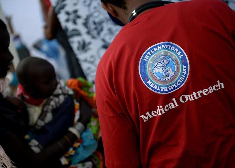 U.S. Air Force Airmen assist patients during a medical outreach event June 22, 2016 at Lokusero, Kenya. The medical outreach was part of the first African Partnership Flight in Kenya. Over the course of three days, medical assistance was provided for more than 1,250 patients. The APF is designed for U.S. and African partner nations to work together in a learning environment to help build expertise and professional knowledge and skills. (U.S. Air Force photo by Tech. Sgt. Evelyn Chavez/Released)