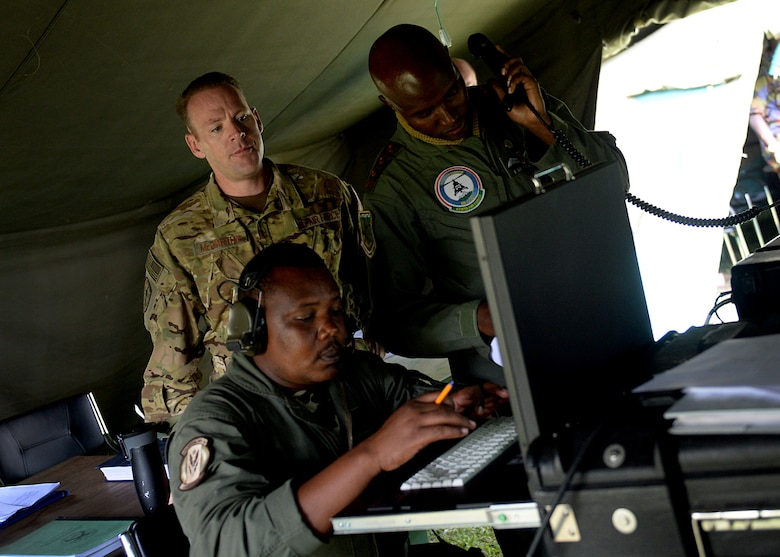 U.S. Air Force Maj. Christopher McCarthy, HH-60G helicopter evaluator pilot, 56th Rescue Squadron, observes Kenyan Defense Force members during African Partnership Flight Kenya June 27, 2016 at Laikipia Air Base, Kenya. The APF is designed for U.S. and African partner nations to work together in a learning environment to help build expertise and professional knowledge and skills. The APF included a Kenyan-led exercise, Linda Rhino, in which instructors observed the application of what was learned in the classroom and provided feedback. The exercise included multiple personnel recovery scenarios. (U.S. Air Force photo by Tech. Sgt. Evelyn Chavez/Released)