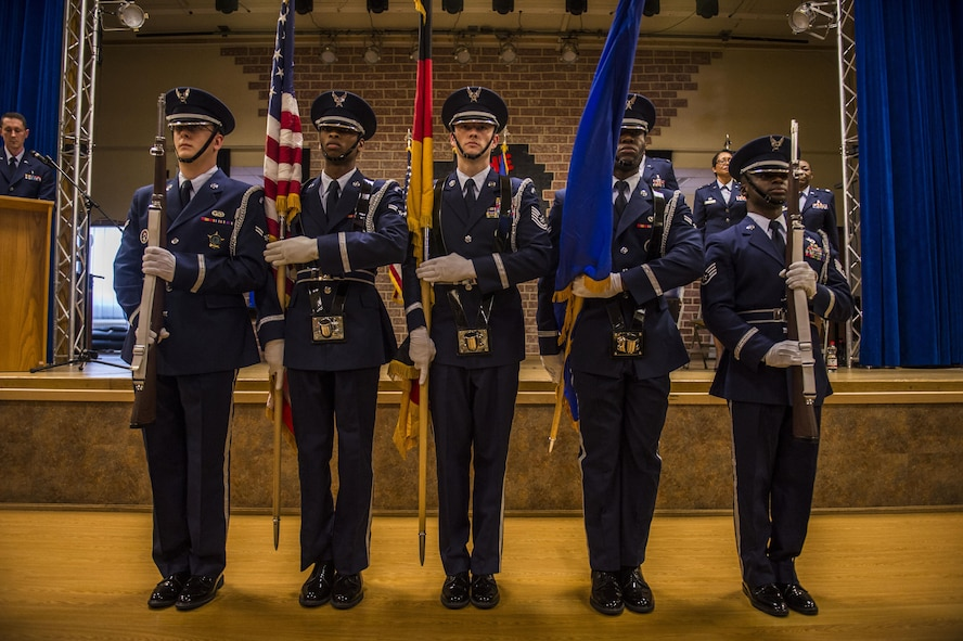 A Spangdahlem Air Base ceremonial guardsmen detail present the colors during the 52nd Medical Operations Squadron change of command ceremony at the Brickhouse on Spangdahlem Air Base, Germany, June 29, 2016. It is tradition for the guardsmen to post both the United States and the host nation's flags depending on where they are stationed. (U.S. Air Force photo by Senior Airman Luke Kitterman/Released)