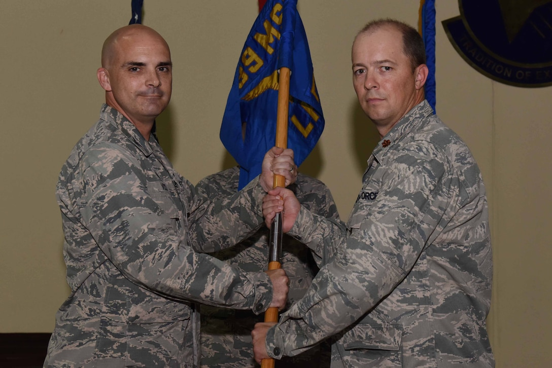 U.S. Air Force Maj. Phillip Wheeler, 39th Logistics Readiness Squadron incoming commander receives the guidon from U.S. Air Force Col. Russell Voce, 39th Mission Support Group commander, during an assumption of command ceremony on June 30, 2016 at Incirlik Air Base, Turkey. Prior to taking command here, Wheeler was the 97th LRS commander at Altus Air Force Base, Oklahoma. (U.S. Air Force photo by Airman 1st Class Devin M. Rumbaugh/Released)
