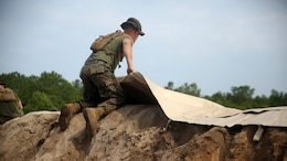 A Marine with Bulk Fuel Company, 8th Engineer Support Battalion, assists in setting up an amphibious assault fuel system at Marine Corps Base Camp Lejeune, North Carolina, June 24, 2016.  A completed AAFS can hold approximately 1.12 million gallons of fuel, which is capable of supporting an entire Marine Expeditionary Force.